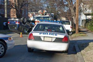 bigstock-Police-and-Fire-Trucks-Surroun-6682258