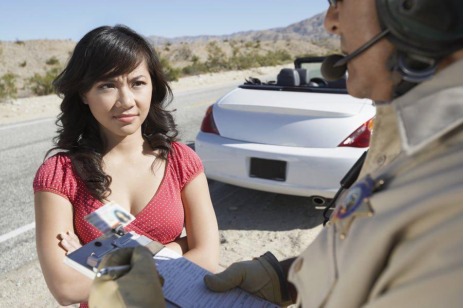 bigstock-Woman-Receiving-Speeding-Ticke-40784707