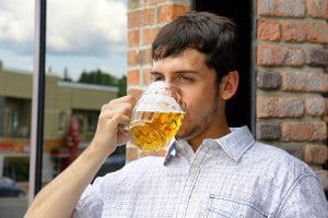 bigstock-Young-Man-Binging-On-Beer-30881735