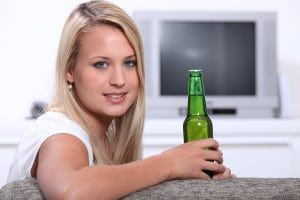 bigstock-Young-woman-at-home-with-a-bot-22825700