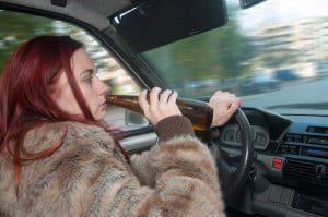 bigstock-Drunk-Woman-Driving-Car-With-B-52205557