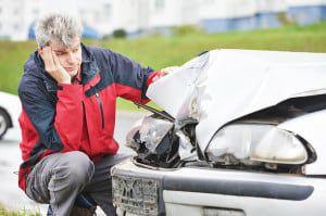 Adult upset driver man inspecting automobile body after crash ca